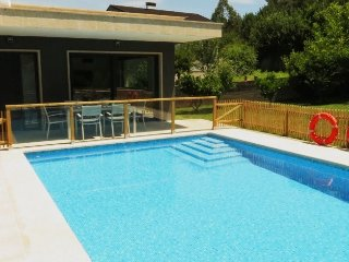 243 Modern looking coastal villa with pool - Vilaboa vacation rentals