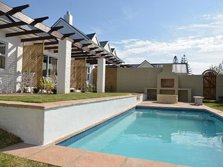 Room 3 selfcatering or B&B in lush garden with private patio and shared pool - Hermanus vacation rentals