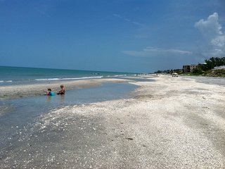 Island living at it's best.  Beach just steps away.  On canal with dock. - Manasota Key vacation rentals