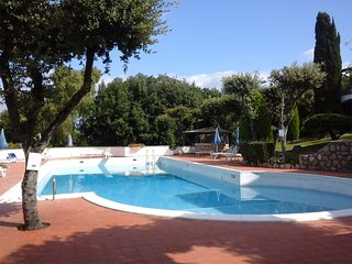 Cozy Condo with Internet Access and Shared Outdoor Pool - Ansedonia vacation rentals