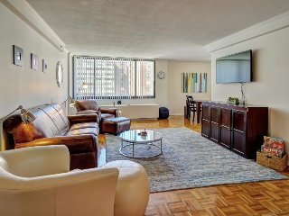 Spacious condo with private balcony, city views, and shared pool access! - Boston vacation rentals