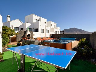 ANY ONE FOR TABLE TENNIS ? , relax in the hot tub after a day of sun bathing - Lanzarote vacation rentals