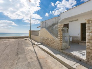 810 Seafront House 10 meters from the Beach of Torre Lapillo - Torre Lapillo vacation rentals