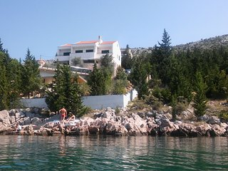 Beautiful  apartment in front of the sea with infinity pool and private beach - Starigrad-Paklenica vacation rentals