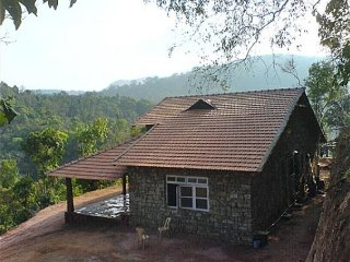 Stone cottage with wooden furnishing ideal for a family, close to Udupi The Veg - Madikeri vacation rentals