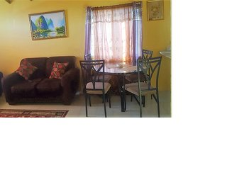 Cozy 2 Bedroom house In A Gated Community 24 hour security on sight play field.. - Old Harbour vacation rentals