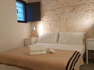 Tranquil oasis beautiful stone home in central Ostuni. Rooftop terrace. WIFI. - Ostuni vacation rentals