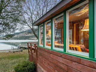 Dog-friendly, waterfront home w/ private hot tub & dock - space over garage - Big Arm vacation rentals