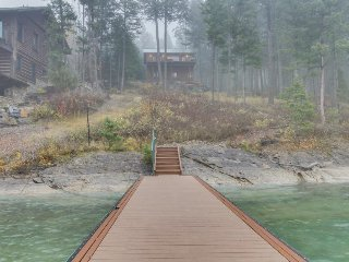 Lakefront getaway with dock, 400 square-foot deck, close to town. - Lakeside vacation rentals