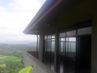 Bungalow perched on a misty hill with an organic veg plot.wifi/ACRooms/Hot water - Peradeniya vacation rentals