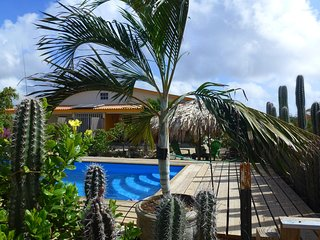 Sunny and colorful holiday home with pool, palmpalapa and porch. - Kralendijk vacation rentals