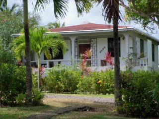 Fully equipped two bedroom cottage with large yard - Calibishie vacation rentals