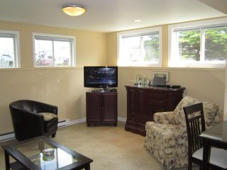 Fully Furnished and Equipped Basement Apartment with Plenty of Natural Light - Torbay vacation rentals