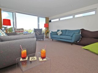 SEAGRASS modern family home, large garden, games room, just beyond the beach at - Crantock vacation rentals